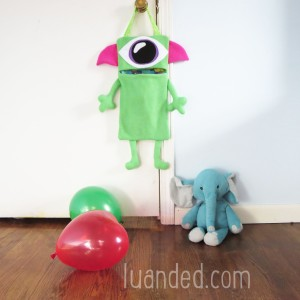 cute green toy holder for kids room