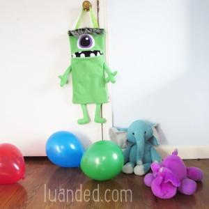 green sweet monster toy holder for nursery