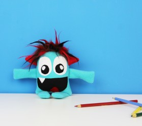 cute blue stuffed monster toy