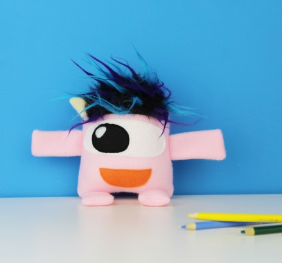 cute light pink stuffed monster toy