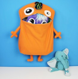 cute orange monster toy holder