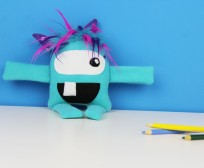 handmade blue stuffed monster toy