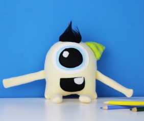 pastel yellow handmade monster toy